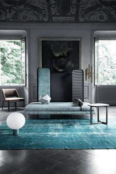 blue/gray/dark living room. living area. big windows. modern with classic elements.