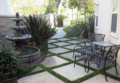 Gray concrete paver patio with grass border and backyard fountain Concrete Paver Patio, Patio Tiles, Patio Flooring, Brick Patios, Patio Stone, Stone Backyard, Patio Diy, Backyard Patio, Backyard Ideas
