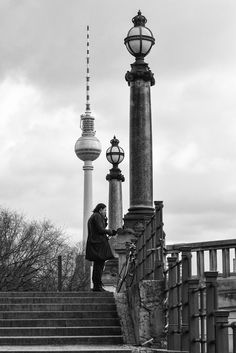 short break - A man stands at the riverside. He is smoking a cigarette and drinking a beer. A short break from everyday life. Black white street photography from Berlin.