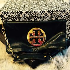 Tory Burch Clutch  Used Tory Burch Clutch. Some scratches on logo...nice soft leather, perfect inside- very clean, on the top flap zip the pull fell off. Love this bag..... price Firm Tory Burch Accessories