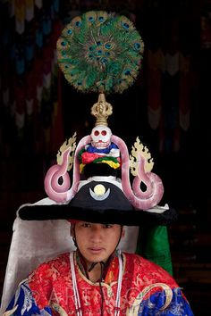 Bhutan © Art Wolfe  I have that peacock feather fan on top of his headdress - MDavenport