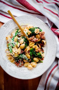 Orecchiette Pasta with Italian Sausage, Broccoli Rabe, Sun-Dried Tomatoes, and Kalamata Olives: this spicy pasta main course can be thrown together in less than 30 minutes and is one of my favorite everyday pasta dishes.