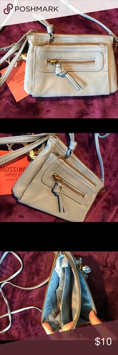 FINAL PRICE DROP. Being donated 4/1 Brand new purse which can be used as a wristlet or crossbody. Lots of compartments! Mossimo Supply Co Bags