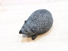 AI/ Concrete figurines. A hedgehog male looking for a soul mate.