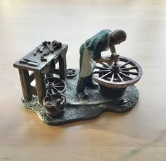 "An excellent and heavy pewter model of a wheelwright at work on a wheel, his tools and other wheels displayed on and around the workbench behind him.Measures approximately 4.1/2"" x 3.1/2"" x 3"" (125 x 90x 75mm). Leonardo Collection, Wood Turning, Cannon, Pewter, Wheels, Victorian, Display, Tools, Architecture"