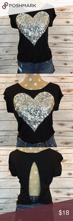 Silver Sequin Heart Top ❤️ Black Open Back Top ❤️ Silver Sequin Heart Detail 💋 Perfect with Jeans or a Skirt 😊 Gently Used 🌺 Back is Unquiely Open and Cute 😘 💯 % Soft Rayon 🎈   🚫 NO TRADES 🌟 POSH Rules Only 🌟 🎉 Customized Bundle Discounts 💋 💗 Offers please use offer button below 🔻 Tops Tees - Short Sleeve