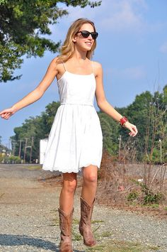 White dress with cowboy boots.  Want to wear something like this to the Zac Brown Band concert.