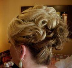 curly texture and loose updo.