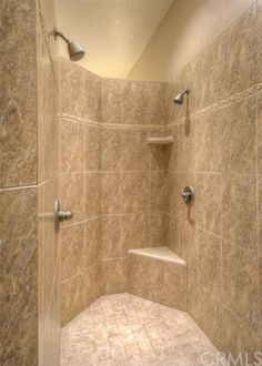 3358 Canyon Oak Terrace Chico, California   The private master retreat features a spacious jacuzzi tub, large shower with dual shower heads, separate vanities, and walk-in closets with custom built-ins.