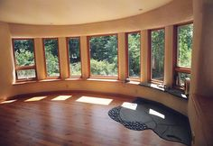 Strawbale rounded window wall. Would be wonderful for a dining room