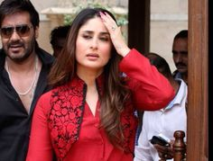 Ajay Devgn, Kareena Kapoor Khan during a promotional event for their upcoming film Satyagraha, in Ahmedabad, on August. Indian Suits, Indian Attire, Indian Wear, Punjabi Suits, Salwar Designs, Blouse Designs, Pakistani Dresses, Indian Dresses, Red Kurti