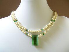 Swarovski pearl necklace with cream swarovski pearls, emerald green crystals and  pendant double strands. $43.00, via Etsy.
