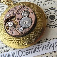 The non-working Swiss watch interior on the front of this antiqued brass locket. | 14 Vintage Locket Details That Are Utterly Delightful