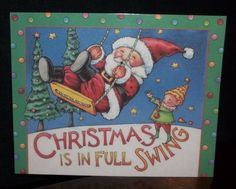 Darling Handcrafted Magnet using Mary Engelbreit Designs/Art/Products. This one features Santa being pushed on a swing by an Elf. Says: Christmas is in Full Swing. Image has been heat laminated and a full magnet has been attached to the back.   eBay!