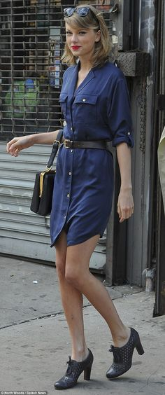 A mischievous glance: Swift gave a playful gaze while exiting the gym, and complimented her complexion with a slick of hot red lipstick