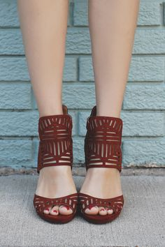These bold beuties are the heels you need this season! All eyes will be on you when you walk in wearing our Fifth Avenue Heels. A pair of faux suede peep toe heels featuring a geometic perforated desi