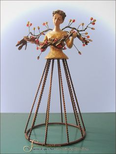 Harvest Santos Cage Doll Angel with Fruit Branch.  [discontinued]