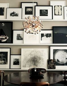 9509b63049c How to display art and black and white photos in this monochrome living room.  For