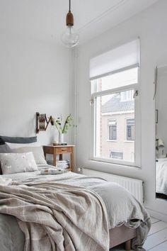 bedroom: minimal + soft greys + greenery + brass wall light