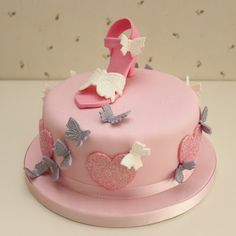 Cute pink and purple butterfly and shoe cake good for a sweet 16 party