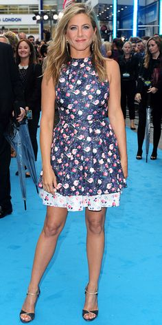 AUGUST 14, 2013 Aniston broke out the florals at the We're the Millers premiere, wearing a printed sleeveless navy Christian Dior dress and ankle-strap Casadei stilettos.