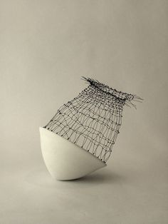 artpropelled:  Yana Goldfine (porcelain and woven steel 2013)
