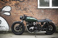 This Kawasaki Z1000 ST by The Wrenchmonkees is actually a great example of the style of their work, their bikes tend to have a gritty, dark, urban feel...