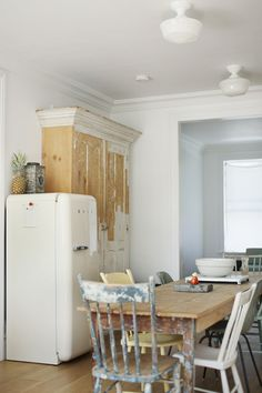 One idea for the kitchen. The smeg would definitely be in it as well as the mismatched chairs! Great armoire!