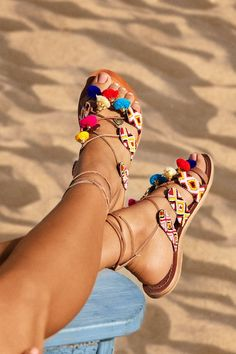 Apple of Eden's pom-pom sandals add an artisanal element to your getaway look. If you can't embrace playful accessories on holiday, when can you?