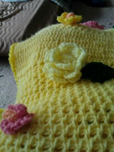 Yellow rose applique and small pink wild rose applique on yellow shawl