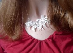 my very own 3d printed reaction-diffusion necklace.Join the 3D Printing Conversation: http://www.fuelyourproductdesign.com/
