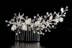 This beautiful beach wedding hair comb will sparkle in your wedding hair style. The design includes rhinestone starfish, clear crystal beads and ivory freshwater pearls or white glass pearls.It is 4.7