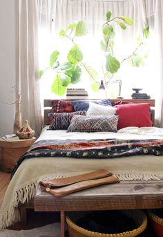 "cream wool bedspread from Uruguay, Kantha bedspread, Morrocan pillows, Kilim pillows, Mongolian Lamb pillow - absolutely lovely. all these colors would be great in an otherwise ""neutral"" (what is neutral?) room"