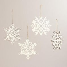 One of my favorite discoveries at WorldMarket.com: Laser-Cut Wood Hanging Snowflakes, Set of 4