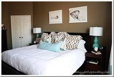 Love the pops of blue & pillows & the B&W photos above bed.