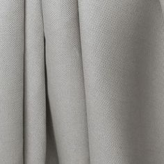 A warm grey upholstery fabric that shows a bit oftexture and character. Perfect for upholstery, drapery, curtains, roman blinds, pillows, seat cushions and man
