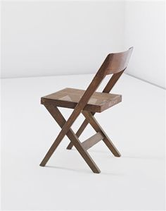 PIERRE JEANNERET 'Library' chair, Chandigarh, India, 1952-1956  Teak, cane. Back of seat painted with 'H.Sc.C (A) 181'. 77 cm. (30 1/4 in.) high