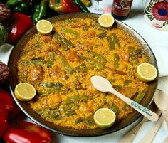 Traditional Valencian paella made with chicken or rabbit, green beans, garrofónes and topped with rosemary