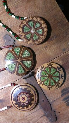 gourd necklaces using pyrography and inlaid with bead work.