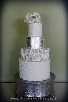 Modern wedding cake with edible silver leaf.