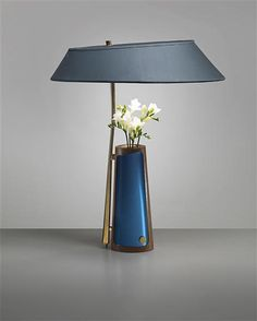 A rare table lamp with integrated vase by MAX INGRAND for Fontana Arte.