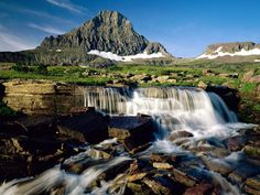 Glacier National Park, Montana. The park takes over 1,000,000 acres (4,000km2) and includes parts of two mountain ranges over 130 lakes, more than 1,000 different species of plants and hundreds of species of animals.