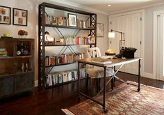 Aged look of the booksehlf and the decor adds to the industrial appeal of the home office