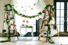 floral garlands - photo by A Brit and A Blonde http://ruffledblog.com/creative-toronto-wedding-with-stylish-backdrops #weddingceremony #backdrops #ceremonies