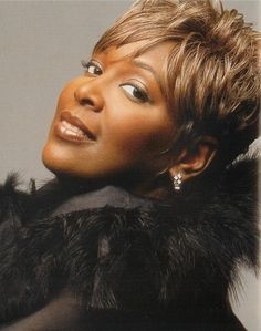 "Lady Tramaine Hawkins. Great voice...and ""The Potter's House"" is one of my favorite Gospel songs."