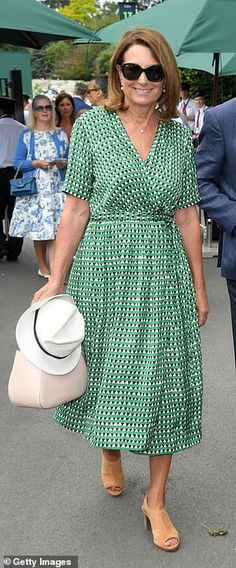Carole Middleton put on a chic display as she arrived for her second appearance at Wimbledon this season alongside husband Michael today, wearing a Scotch and Soda printed green wrap dress. Carole Middleton, Middleton Family, Pippa And James, Spring Into Action, Wimbledon, Duchess Of Cambridge, Frocks, Wrap Dress, Style Inspiration