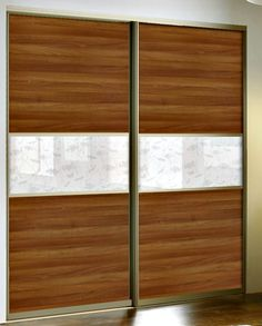 Gliding gold framed aluminium wardrobe doors in maple and white honeysuckle glass insert £927