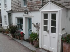 Louisa Glasson's cottage in DocMartin's, in Port Isaac...  - Book Local Traders --> https://SnipTask.com
