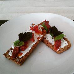 bruchettas with basil, leman basil, sundried tomatoes and cream cheese