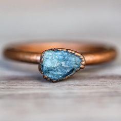 Raw Sapphire Ring Raw Sapphire and Copper Ring Please note that size, shape and colour of stone may vary Part of our 'Bohemian' Collections
